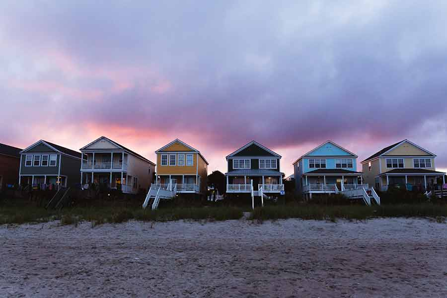 Row of beach houses during sunset